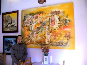 artist with painting